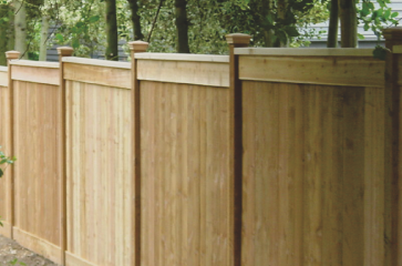 wood-fence-that-is-installed-on-a-slope
