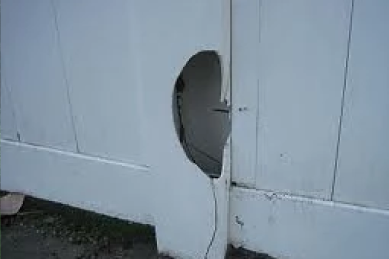 damaged-fence-post-with-hole-in-it