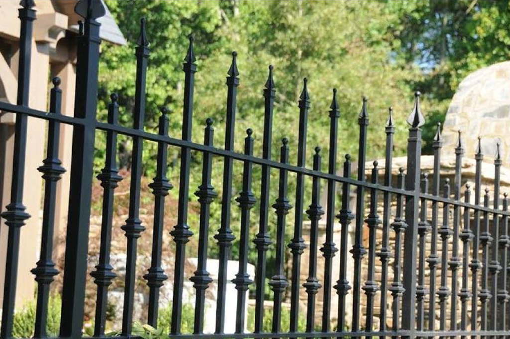 ornamental-wrought-iron-fence-surrounding-a-property